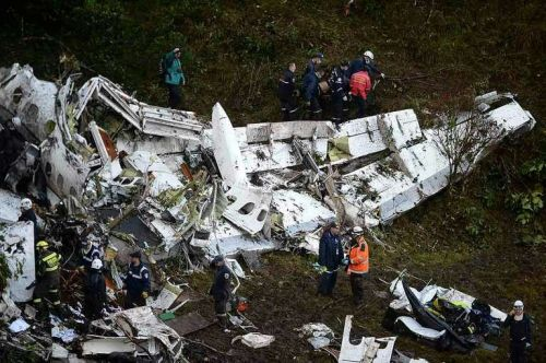Rescuers search for survivors from the wreckage