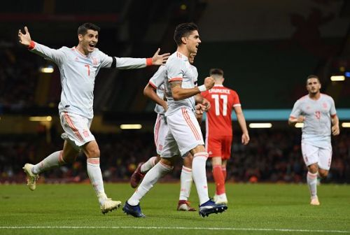 Spain players celebrate during a dominant display against Wales