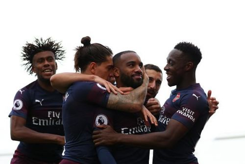 Lacazette celebrates with teammates after scoring against Fulham