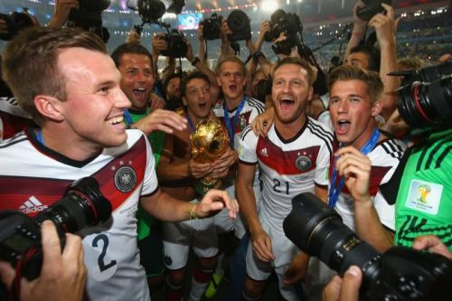 """""""Many of them poured into the streets that night wearing Ozil's No. 10 jersey,""""  Boyd writes on Germany's victory in the 2014 World Cup final over Argentina. """"His victory was theirs."""""""