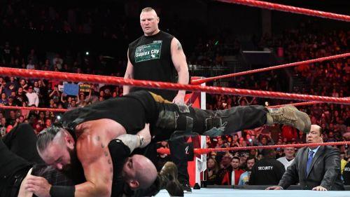 Strowman attacks Baron Corbin as Lesnar looks on