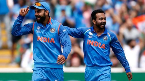 Kohli and Jadhav celebrating after a fall of
