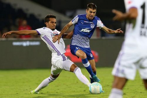 A file picture of Sahil Panwar of FC Pune City (left) in a tussle for possession with Bengaluru FC's Toni Dovale (Image: ISL)