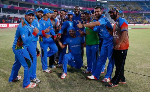 The Afghanistan team with Chris Gayle after defeating the West Indies in the 2016 ICC T20 World Cup