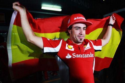 Alonso celebrates after winning the 2012 Malaysian Grand Prix