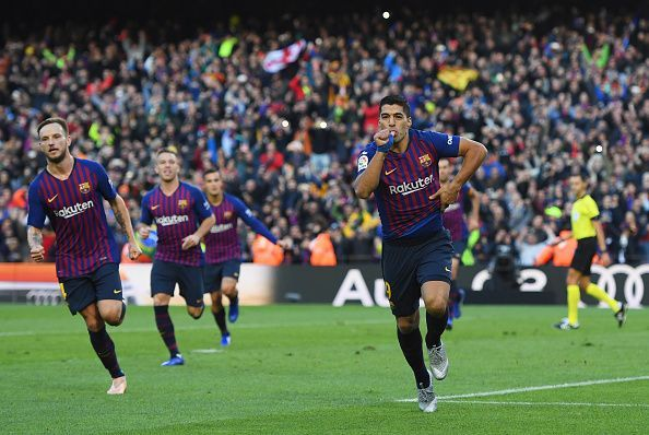 Suarez wheels away to celebrate one of his three goals against Real during a memorable El Clasico