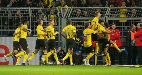 Dortmund players celebrating a goal.