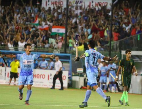 Manpreet Singh celebrates his goal with Chinglensana Singh