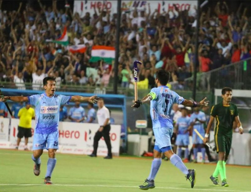Manpreet Singh celebrates his goal with Chinglensana Singh