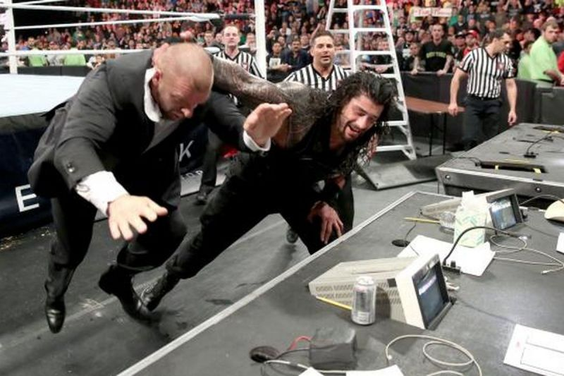 Roman Reigns attacks Triple H