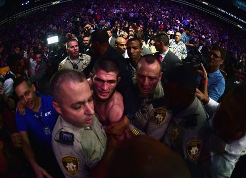 Khabib is restrained by security in the incredible aftermath of UFC 229