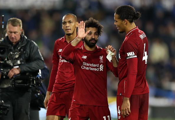 Relief: Salah celebrates post-match with van Dijk and Fabinho, the latter making his Premier League debut