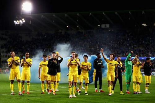 Dortmund players celebrate with the away fans after their win over Club Brugge