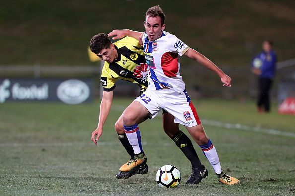 45d590767be Australia s Angus Thurgate (in white jersey) plays for the Newcastle Jets in  the Australian
