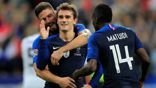Griezmann celebrates after scoring from the spot