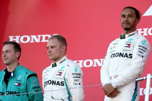 Hamilton stands on top of the podium at the F1 Grand Prix of Japan