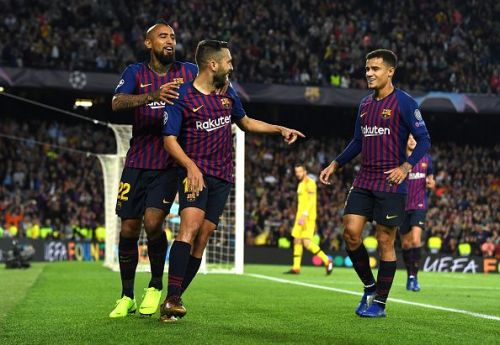 Alba (center) celebrates his finish with Arturo Vidal and Philippe Coutinho as Barcelona seal all three points