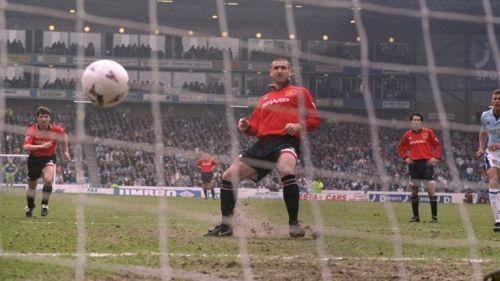 Eric Cantona slots home a penalty