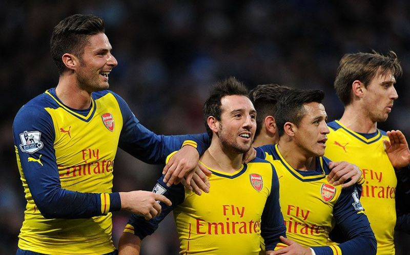 Santi Cazorla celebrates with teammates after scoring against Manchester City