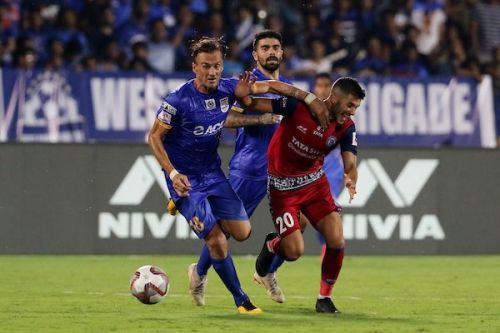 Lucian Goian of Mumbai City FC (left) vies for the ball and Sergio Cidoncha of Jamshedpur FC (right)
