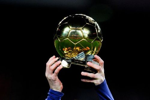 Messi holding up the Ballon d'Or