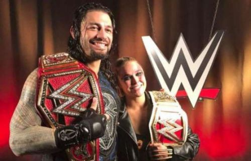 Ronda Rousey with Roman Reigns following their respective title wins at SummerSlam
