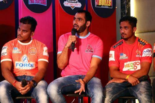 Rare sight: Anup Kumar (centre) in a Pink Panthers jersey