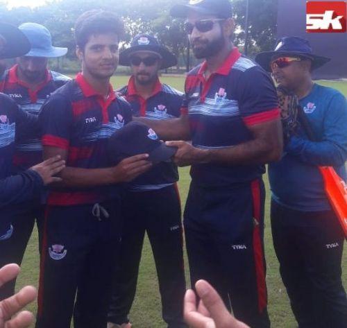 Rasikh Salam getting his debut cap from Irfan Pathan