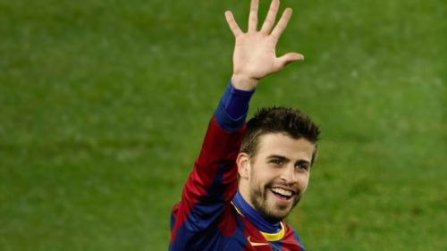 Gerard Pique's symbolising the 5-0 victory after the match with his hand