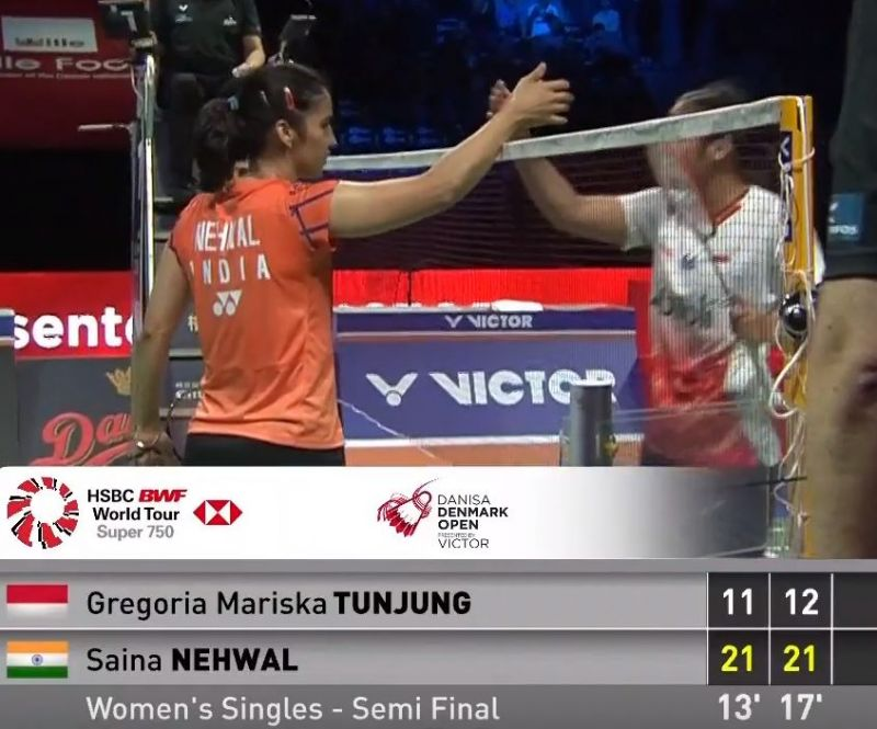 Nehwal shakes hands with Tunjung after her victory