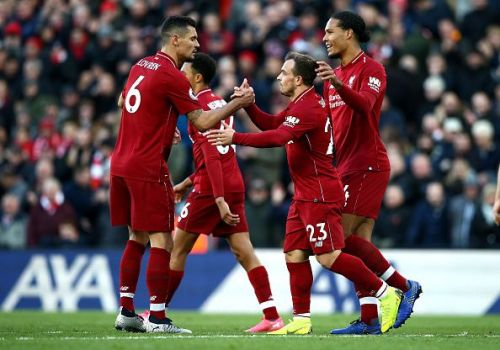 Liverpool players celebrate during their 4-1 over Cardiff City at Anfield