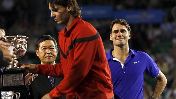 Nadal receiving the 2009 Australian Open Trophy with a tearful Federer in the backdrop