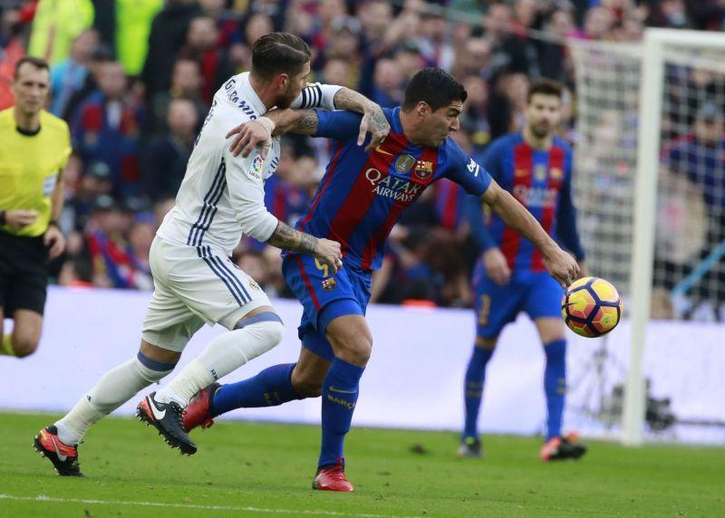Luis Suarez and Sergio Ramos Luis Suarez and Sergio Ramos. FC Barcelona  host Real Madrid ... 3770df97fbec6