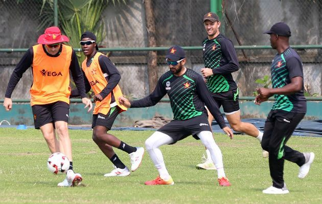 Sikandar Raza while playing football during the practice in Mirpur