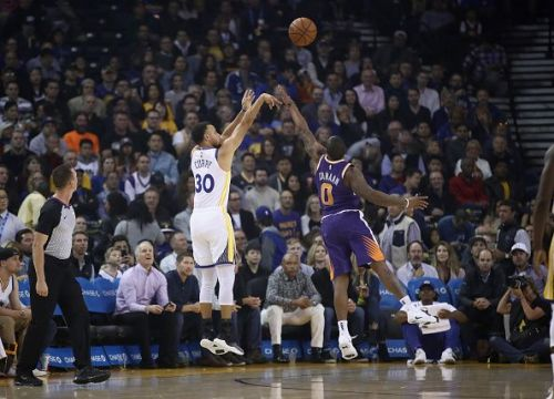 Stephen Curry shoots over the defender