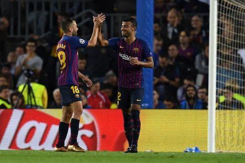 Rafinha celebrates the opening goal with Jordi Alba