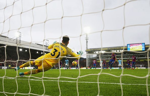 Ederson in action against Crystal Palace