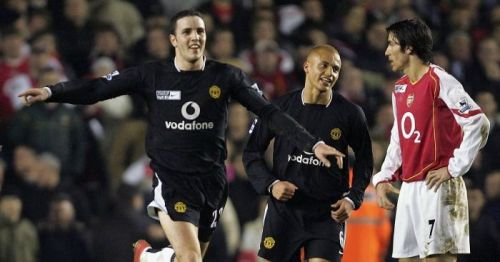 John O'Shea celebrating after scoring against Arsenal at Highbury