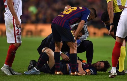 Messi after he fell on the ground with an injury