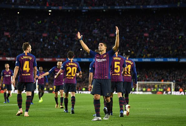 Barcelona players celebrate Suarez's hat-trick during their 5-1 thrashing over Real Madrid