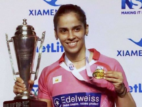 Saina Nehwal with the Australian open Superseries trophy and medal