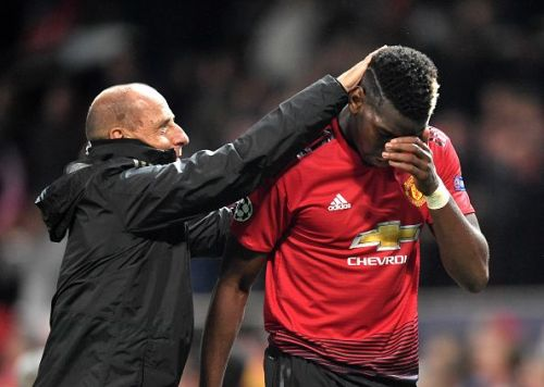 Paul Pogba is consoled after the game