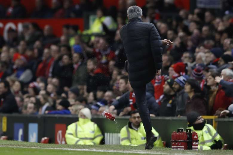 Mourinho kicks a water bottle, frustrated by the referee