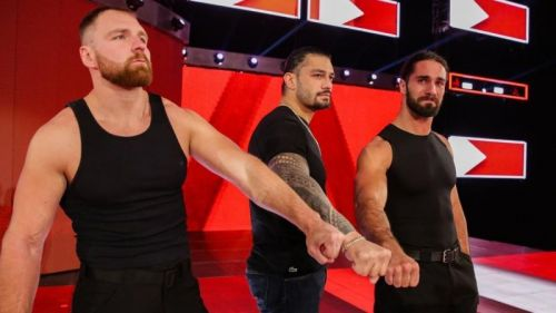 Roman Reigns, with his Shield Brothers, moments after announcing that he was vacating the Universal Title and taking a leave of absence to battle Leukemia