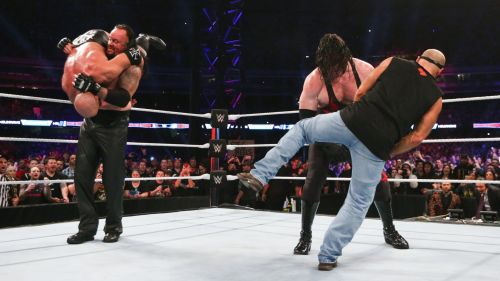 Kane and The Undertaker laid out Triple H and Shawn Michaels to close the show