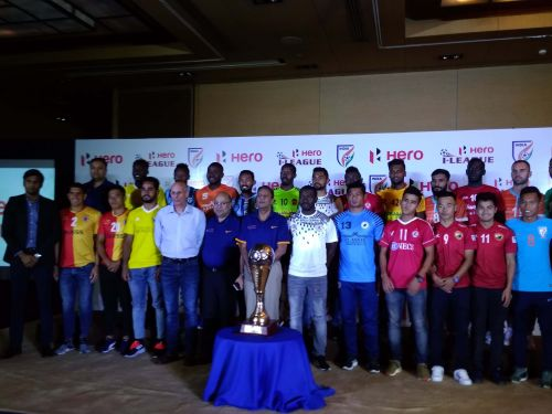 Kushal Das (bottom row, behind trophy) with players of other teams.