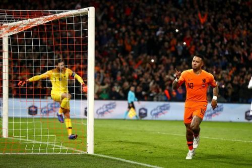 Depay wheels away to celebrate his Panenka penalty in stoppage-time during a memorable win