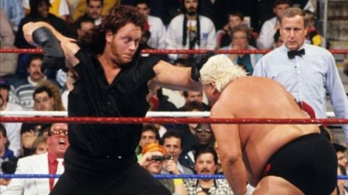 Undertaker punching the lights out of Dusty Rhodes.