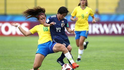 Misaki Morita of Japan on the right in action against Julia of Brazil (Image Courtesy: FIFA)