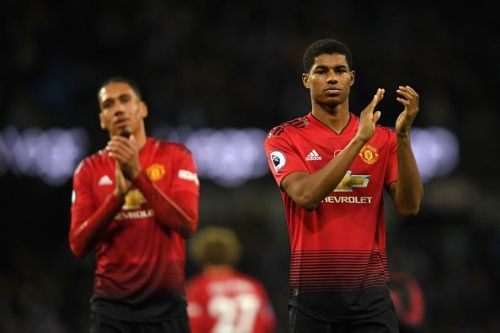 Rashford (right) applauds the fans after United's frustrating defeat by rivals City